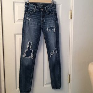 AMERICAN EAGLE patched jeans.